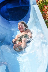 Girl sliding down waterslide