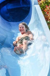 Girl sliding down waterslide
